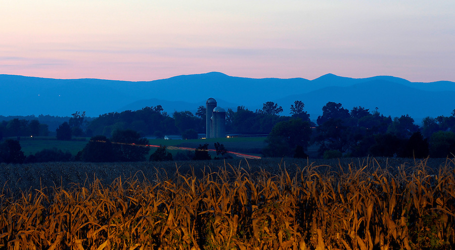 A farm at sunset with the Blue Ridge Mountains behind in Orange County, VA. Photo/Andrew Shurtleff