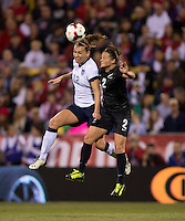 Lauren Holiday (12) of the USWNT goes up for a header with Ria Percival (2) during an international friendly at Crew Stadium in Columbus, OH. The USWNT tiedNew Zealand, 1-1.