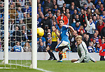 Jason Holt beats keeper Robbie Thomson to score for Rangers