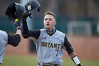 Jake Gustin (7) of the Bryant Bulldogs is greeted by teammates after hitting a solo home run against the High Point Panthers at Williard Stadium on February 21, 2021 in  Winston-Salem, North Carolina. The Panthers defeated the Bulldogs 3-2. (Brian Westerholt/Four Seam Images)