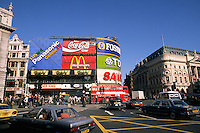 Traffic on Piccadilly Circus with the famous neon signs in London England