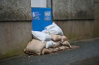 Friday 14 February 2014<br /> Pictured:Sandbags and a flood barrier are stacked in front of a doorway in Laugarne, West Wales<br /> Re: Rain and gale force winds are again due to batter the UK