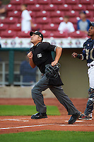 Umpire Arturo Gonzalez during a game between the Kane County Cougars and Cedar Rapids Kernels on August 18, 2015 at Perfect Game Field in Cedar Rapids, Iowa.  Kane County defeated Cedar Rapids 1-0.  (Mike Janes/Four Seam Images)