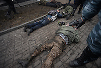 Policemen arrest some protesters in Maidan square.  Kiev, Ukraine