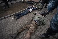 Policemen arrest some protesters in Maidan square.  Kiev, Ukraine