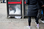 © Joel Goodman - 07973 332324 . 06/04/2017 . Manchester , UK . A man lies curled up on the floor of a telephone box after consuming a rolled cigarette believed to contain spice . An epidemic of abuse of the drug spice by some of Manchester's homeless population , in plain sight , is causing users to experience psychosis and a zombie-like state and is daily being witnessed in the Piccadilly Gardens area of Manchester , drawing large resource from paramedic services in the city centre . Photo credit : Joel Goodman