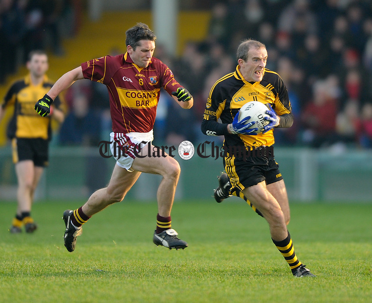 Paudie Kissane of Clyda Rovers in action against Gordon Kelly of Miltown during their Intermediate Club Munster Final at The Gaelic Grounds. Photograph by John Kelly.