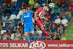 Getafe CF's Jorge Molina (l) and Atletico de Madrid's Lucas Hernandez during friendly match. August 11,2017. (ALTERPHOTOS/Acero)
