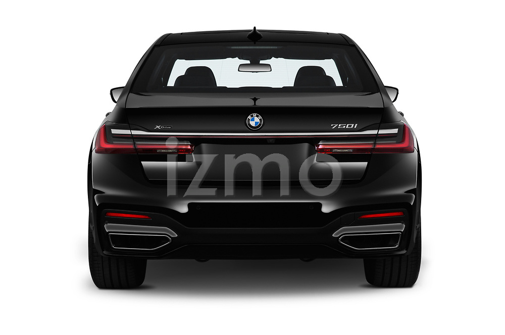 Straight rear view of a 2020 BMW 7 Series M Sport 4 Door Sedan stock images