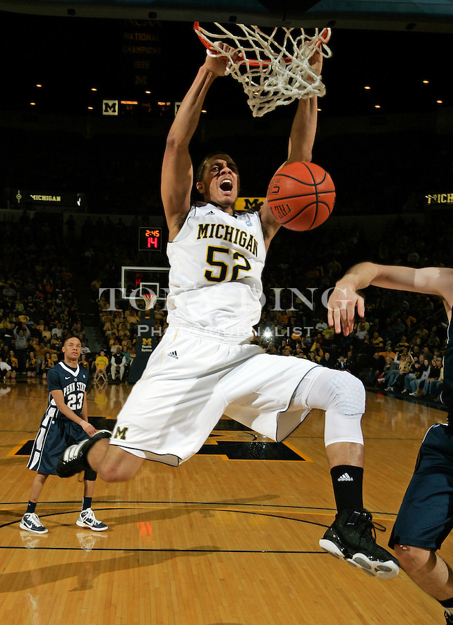 Michigan forward Jordan Morgan (52) dunks the ball in the second half of an NCAA college basketball game with Penn State, Sunday, Jan. 2, 2011, at Crisler Arena in Ann Arbor. Michigan won 76-69.(AP Photo/Tony Ding)