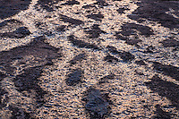Runoff from recent rains reflects the sunset at Enchanted Rock State Natural Area.<br /> <br /> Canon EOS 5D, Tokina 100mm f/2.8mm macro lens