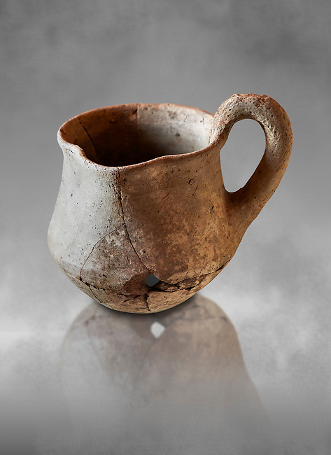 Hittite terra cotta cult side handled spouted jug. Hittite Period 1650 - 1450 BC, Ortakoy Sapinuvwa .  Çorum Archaeological Museum, Corum, Turkey. Against a grey bacground.