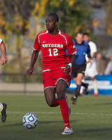 Rutgers University forward Kene Eze (12) brings the ball forward.  Rutgers University defeated Boston College in penalty kicks after two overtime periods in NCAA Division I tournament action, at Newton Campus Field, November 20, 2011.