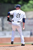 Asheville Tourists starting pitcher Trey Killian (21) delivers a pitch during a game against the Charleston RiverDogs at McCormick Field on July 10, 2016 in Asheville, North Carolina. The Tourists defeated the RiverDogs 4-2. (Tony Farlow/Four Seam Images)