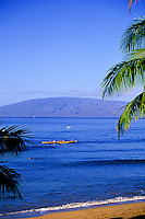 Outrigger canoe in ocean at Kapalua bay with Molokai in background
