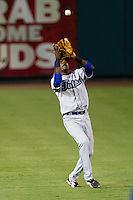 Hector Gomez (5) of the Tulsa Drillers catches a ball in shallow left field during a game against the Springfield Cardinals at Hammons Field on July 18, 2011 in Springfield, Missouri. Tulsa defeated Springfield 13-8. (David Welker / Four Seam Images)