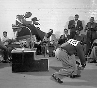 Curtis Phillips (18) performs at Third Annual WIlson Shoeshine Contest, Wilson, North Carolina, 1952. Photo by John G. Zimmerman.
