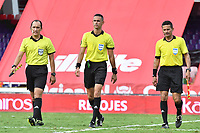 CALI - COLOMBIA, 04-04-2021: John Aguilar, arbitro asistente 2, Carlos Ortega, arbitro central, Dionisio Ruiz, arbitro asistente 1, previo al partido entre América de Cali y La Equidad por la fecha 17 como parte de la Liga BetPlay DIMAYOR 2021 jugado en el estadio Pascual Guerrero de la ciudad de Cali. / John Aguilar, assistant referee 2, Carlos Ortega, central referee, Dionisio Ruiz, assistant referee 1, prior a match between America de Cali and La Equidad for the date 17 as part of BetPlay DIMAYOR League 2021 played at the Pascual Guerrero stadium in Cali city. Photos: VizzorImage / Nelson Rios / Cont.