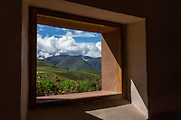 Peru, Moray, Urubamba Valley.   Looking out on Farmland and the Andes Mountains,  Parador de Moray.