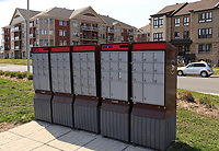 Brossard, canada, May 4, 2015.<br /> <br /> Canada Post outside mailboxes in brossard suburb south of Montreal.<br /> Canada post plan to stop door to door mail delivery.<br /> <br /> Photo : Pierre Roussel - Agence Quebec Presse