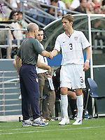 Bob Bradley shakes hands with Clarence Goodson as he comes off the field. USA defeated Grenada 4-0 during the First Round of the 2009 CONCACAF Gold Cup at Qwest Field in Seattle, Washington on July 4, 2009.