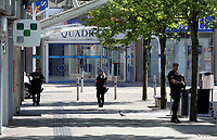 Pictured: An armed police officer in Union Street in Swansea city centre with the entrance to the Quadrant in the background Wednesday 24 May 2017<br />Re: The Quadrant shopping centre in Swansea has been evacuated following reports of a suspicious package being found.<br />The bus station and Swansea Indoor Market have also been closed as part of the evacuation.