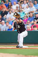 Charlotte Knights first baseman Andy Wilkins (17) stretches for a throw during the game against the Scranton/Wilkes-Barre RailRiders at BB&T Ballpark on July 17, 2014 in Charlotte, North Carolina.  The Knights defeated the RailRiders 9-5.  (Brian Westerholt/Four Seam Images)