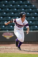 J.J. Muno (12) of the Winston-Salem Rayados hustles down the first base line against the Potomac Nationals at BB&T Ballpark on August 12, 2018 in Winston-Salem, North Carolina. The Rayados defeated the Nationals 6-3. (Brian Westerholt/Four Seam Images)