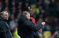 Man Utd manager Ole Gunnar Solskjaer talks to substitute Paul Pogba of Man Utd during the Premier League match between Watford and Manchester United at Vicarage Road, Watford, England on 22 December 2019. Photo by Andy Rowland.