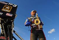 Feb. 19, 2012; Chandler, AZ, USA; NHRA top fuel dragster driver Antron Brown celebrates after winning the Arizona Nationals at Firebird International Raceway. Mandatory Credit: Mark J. Rebilas-