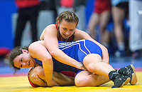 11 MAY 2014 - SHEFFIELD, GBR - Sarah Grundy (top) and Chloe Spiteri (bottom) attempt to gain control during their women's 63kg category freestyle match at the British 2014 Senior Wrestling Championships in EIS in Sheffield, Great Britain (PHOTO COPYRIGHT © 2014 NIGEL FARROW, ALL RIGHTS RESERVED)