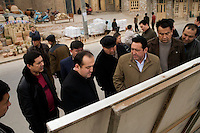 Government officials tour a public display of construction plans for the Old City of Kashgar, Xinjiang, China.  The display provides visual evidence of houses in poor condition and lays out plans for the future of the city.