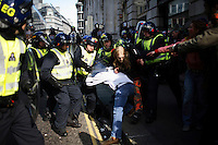 Riot police strike out at two protestors by the Bank of England as thousands of protestors descended on the City of London ahead of the G20 summit of world leaders to express anger at the economic crisis, which many blame on the excesses of capitalism.