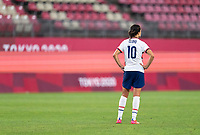 KASHIMA, JAPAN - AUGUST 2: Carli Lloyd #10 of the USWNT walks across the field after a game between Canada and USWNT at Kashima Soccer Stadium on August 2, 2021 in Kashima, Japan.