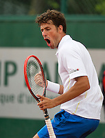 France, Paris, 26.05.2014. Tennis, Roland Garros, Robin Haase (NED) reacts with a fist in his match against  Nicolay Davydenko (RUS) <br /> Photo:Tennisimages/Henk Koster