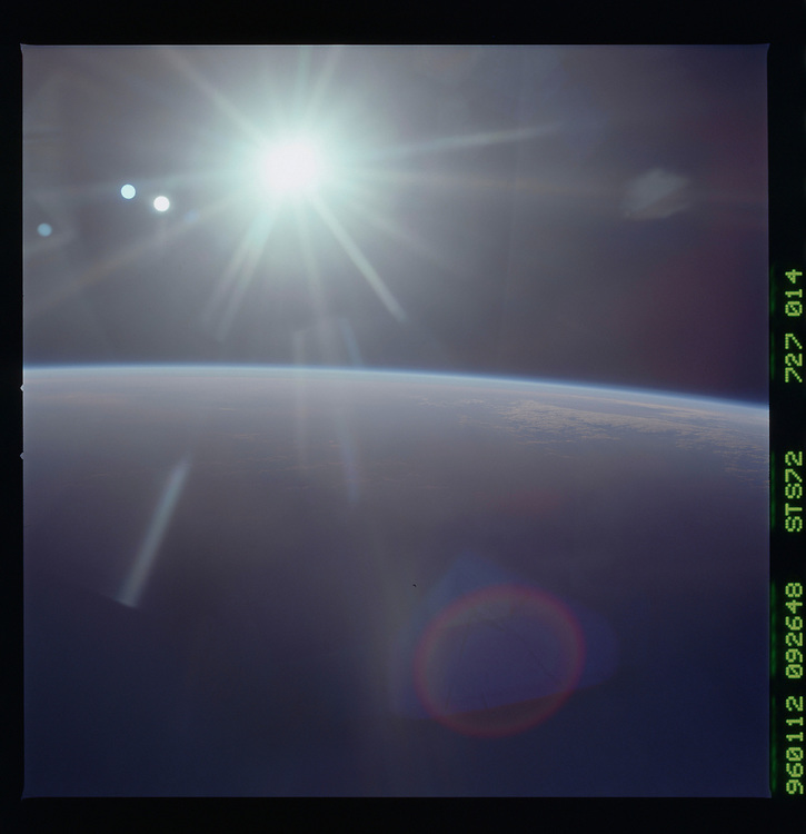 John Angerson. STS-72 Book.<br /> Public Domain Image.<br /> NASA images Courtesy National Archives - Record Group number: 255-STS-STS072<br /> Description: Earth observations taken from shuttle orbiter Endeavour during STS-72 mission<br /> <br /> Subject Terms: STS-72, ENDEAVOUR (ORBITER), EARTH OBSERVATIONS (FROM SPACE), EARTH LIMB<br /> <br /> Date Taken: 1/12/1996<br /> <br /> Categories: Earth Observations<br /> <br /> Interior_Exterior: Exterior<br /> <br /> Ground_Orbit: On-orbit<br /> <br /> Original: Film - 70MM CT<br /> <br /> Preservation File Format: TIFF<br /> <br /> feat: EARTH LIMB, SUN, REFL.<br /> <br /> nlat: -20.3<br /> <br /> nlon: 151<br /> <br /> azi: 242<br /> <br /> alt: 199<br /> <br /> elev: -10