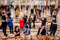 Theatre goers mingle before a performance at the Astana Opera.