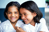 Osa Peninsula, Costa Rica. Two laughing, smiling schoolgirls.