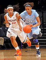 CHARLOTTESVILLE, VA- JANUARY 5: Brittany Rountree #11 of the North Carolina Tar Heels drives past Ariana Moorer #15 of the Virginia Cavaliers during the game on January 5, 2012 at the John Paul Jones arena in Charlottesville, Virginia. North Carolina defeated Virginia 78-73. (Photo by Andrew Shurtleff/Getty Images) *** Local Caption ***  Brittany Rountree;Ariana Moorer