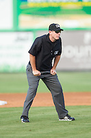 Umpire Russ Weich handles the calls on the bases during the Appalachian League game between the Johnson City Cardinals and the Burlington Royals at Burlington Athletic Park on July 14, 2014 in Burlington, North Carolina.  The Cardinals defeated the Royals 9-4.  (Brian Westerholt/Four Seam Images)