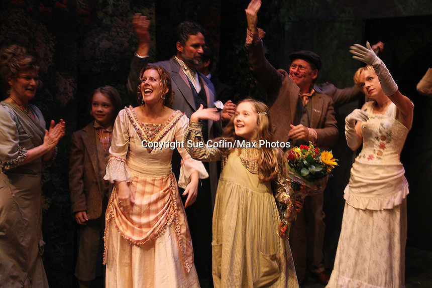 """Secret Garden cast curtain call - includes Liz Keifer and daughter Isabella Convertino as Philipstown Depot Theatre presents The Secret Garden on November 15, 2009 in Garrison, New York. The musical The Secret Garden is the story of """"Mary Lennox"""", a rich spoiled child who finds herself suddenly an orphan when cholera wipes out the entire Indian village where she was living with her parents. She is sent to live in England with her only surviving relative, an uncle who has lived an unhappy life since the death of his wife 10 years ago. """"Archibald's son Colin"""", has been ignored by his father who sees Colin only as the cause of his wife's death.This is essentially the story of three lost, unhappy souls who, together, learn how to live again while bringing Colin's mother's garden back to life. (Photo by Sue Coflin/Max Photos)...."""
