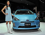 November 30, 2011, Tokyo, Japan - Toyota introduces Aqua, its smallest hybrid vehicle, to tap demand among younger consumers seeking a fuel- efficient entry-level car during a press preview of the Tokyo Motor Show on Wednesday, November 30, 2011. ..The Tokyo Motor Show opened to the press Wednesday as Japanese automakers unveiled a bevy of electric cars and other green vehicles at a much smaller venue in central Tokyo, to which the show moved from the nations largest exhibition hall in neighboring Chiba prefecture after 24 years. A total of 176 brands from 13 countries and regions participated in the show. The number of foreign automakers has increased to 24 from previous nine. Out of 398 models, 52 will be shown for the very first time. An estimated 800,000 visitors are expected to attend the week-long exhibition, compared with 1.5 million in 2005, according to the organizers.(Photo by Natsuki Sakai/AFLO) [3615] -mis-.