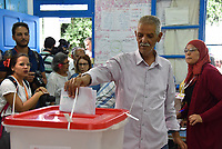 TUNIS, TUNISIA - SEPTEMBER 15: Tunisians cast their vote at a polling station during the presidential elections in Tunis, Tunisia on September 15, 2019