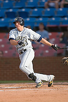 Luke Murton #34 of the Georgia Tech Yellow Jackets follows through on his swing versus the Wake Forest Demon Deacons at Wake Forest Baseball Park April 18, 2009 in Winston-Salem, NC. (Photo by Brian Westerholt / Four Seam Images)