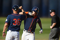 Michael Lorenzen #55 of the Cal State Fullerton Titans is greeted by third base coach Chad Baum #36 after hitting a home run against the Nebraska Cornhuskers at Goodwin Field on February 16, 2013 in Fullerton, California. Cal State Fullerton defeated Nebraska 10-5. (Larry Goren/Four Seam Images)