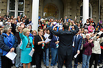 """Lt. Gov. Brian Krolicki, with his back to camera, leads the crowd in song Thursday, Oct. 30, 2014 during #NevadaSings!, a statewide sing-a-long of """"Home Means Nevada."""" Approximately 370 people took part in the Carson City portion of the event, which seeks to establish a new record for the most people in an American state to sing their state song at the same time. The Carson City crowd gathered on the Capitol steps."""