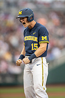 Michigan Wolverines first baseman Jimmy Kerr (15) celebrates driving in a run during Game 6 of the NCAA College World Series against the Florida State Seminoles on June 17, 2019 at TD Ameritrade Park in Omaha, Nebraska. Michigan defeated Florida State 2-0. (Andrew Woolley/Four Seam Images)