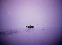 Single fishing boat in calm water