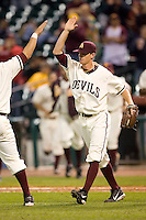 Arizona State freshman Mike Leake (8) high fives a teammate after closing out the Sun Devils 5-4 over Texas A&M at the 2007 Houston College Classic at Minute Maid Park in Houston, TX, Friday, February 9, 2007.
