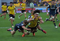 Michael Collins (left) and Aaron Smith tackle Du'Plessis Kirifi during the Super Rugby Aotearoa match between the Hurricanes and Highlanders at Sky Stadium in Wellington, New Zealand on Sunday, 12 July 2020. Photo: Dave Lintott / lintottphoto.co.nz